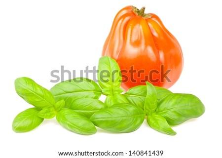 beefsteak tomato and basil  isolated on white - stock photo