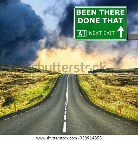 BEEN THERE DONE THAT road sign against clear blue sky - stock photo