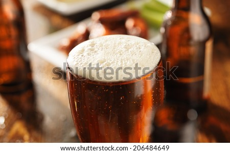 beer and bbq chicken wings shot in panoramic format - stock photo