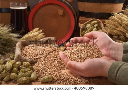 beer and beer barrel â?? hops, wheat, grain, barley and malt isolated on black - stock photo