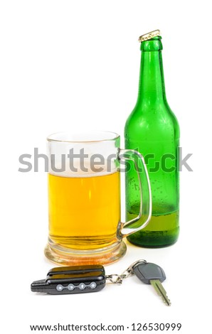 Beer and car keys. The photo on the white background - stock photo