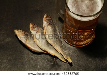 Beer and dried fish. Russian snack .
