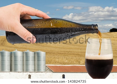 Beer and factory on the background. Blue sky - stock photo