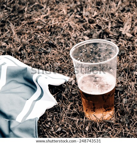 Beer and football dress on grass - retro style - stock photo