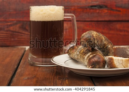 beer and grill sausage  on wooden background