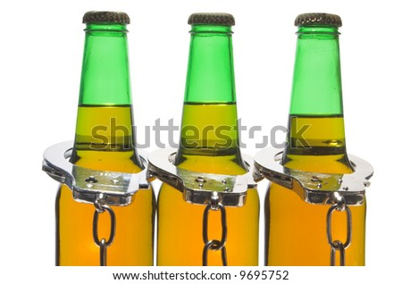 Beer and Handcuffs - Drinking and Driving Concept - stock photo