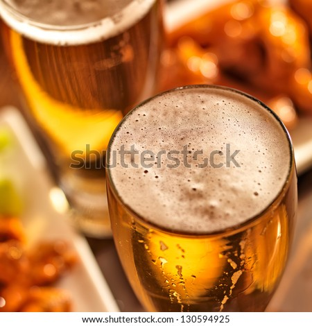 beer and wings at celebration - stock photo