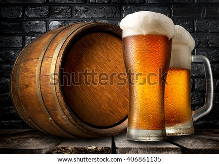Beer and wooden keg - stock photo