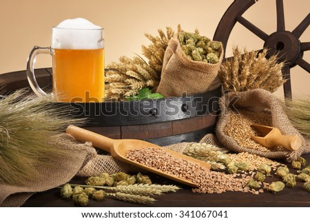 beer barrel, beer glass with hops, wheat, grain, barley and malt