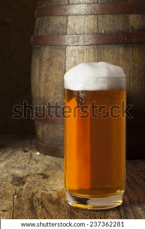 Beer barrel with beer glasses on a wooden table - stock photo