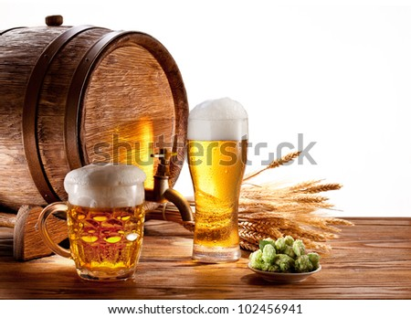 Beer barrel with beer glasses on a wooden table. Isolated on a white background. - stock photo
