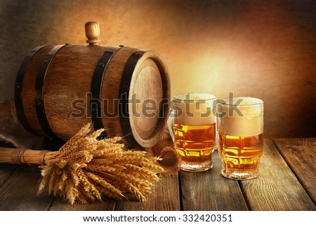 Beer barrel with beer glasses on table on brown background - stock photo