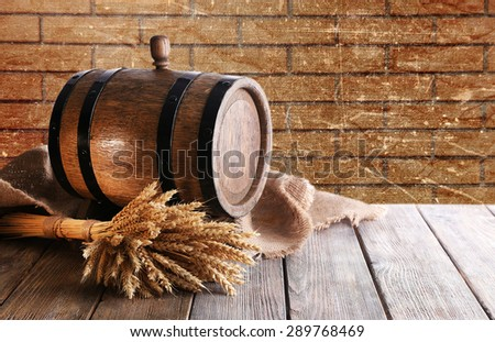 Beer barrel with beer on table - stock photo