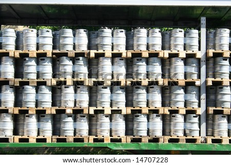 beer barrels in a stack - preparing to transportation, background - stock photo
