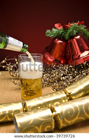 beer being poured on a christmas table - stock photo