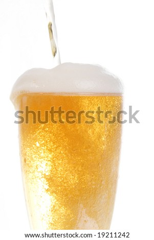 Beer being poured onto tall glass over white background - stock photo