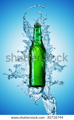 beer bottle being poured in a water on blue - stock photo
