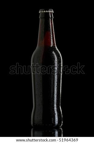 beer bottle dark on black - stock photo