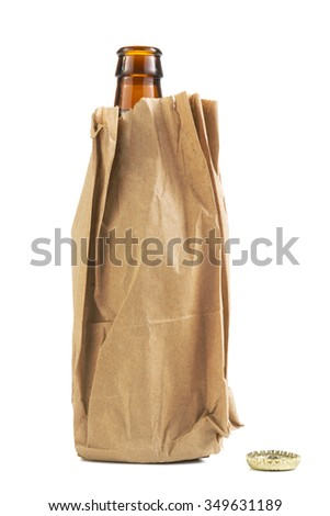Beer bottle in a brown paper bage isolated tight crop