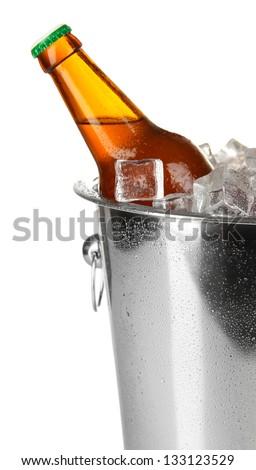 Beer bottle in ice bucket isolated on white - stock photo