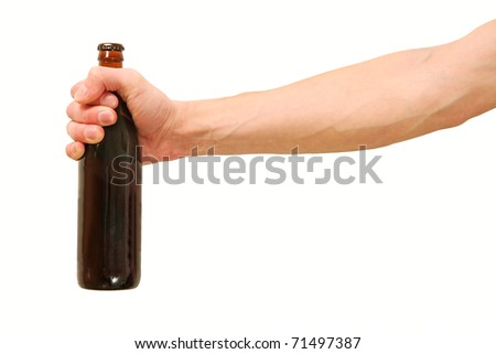 Beer bottle in the hand - stock photo