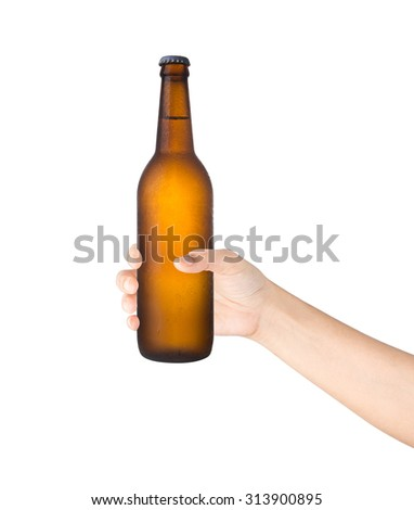 Beer bottle in the hand isolated on white background. - stock photo