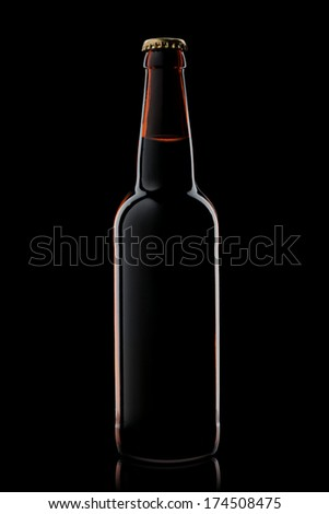 Beer bottle isolated on black - stock photo