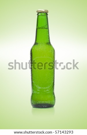 Beer bottle isolated on green background - stock photo