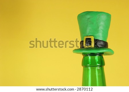 Beer bottle with a funny cork (St. Patrick' s day style) - stock photo