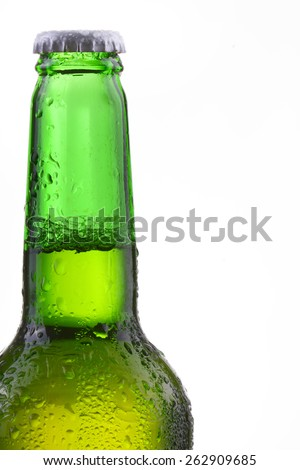 Beer bottle with drops isolated on wgite - stock photo