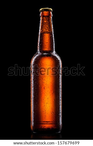 Beer bottle with water drops isolated on black - stock photo