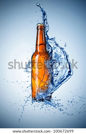 Beer bottle with water splash - stock photo