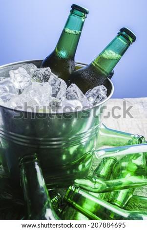 Beer bottles in a bucket - stock photo