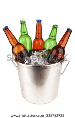 beer bottles in a bucket of ice isolated on a white background. - stock photo