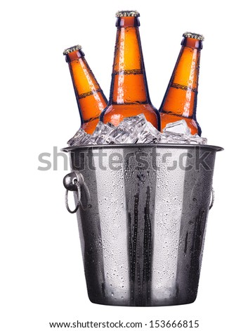 Beer bottles in ice bucket isolated on white - stock photo