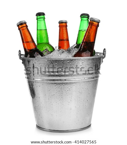 Beer bottles in ice bucket, isolated on white - stock photo
