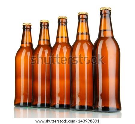 Beer bottles isolated on white - stock photo