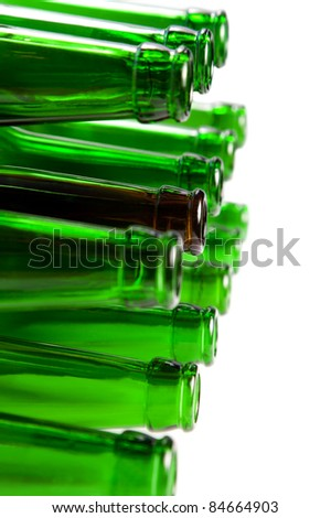 Beer bottles of green glass and a brown isolated on white background - stock photo