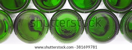 Beer bottles of green glass background, glass texture
