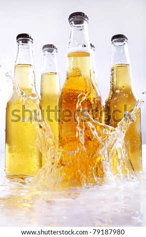 Beer bottles with water splash - stock photo