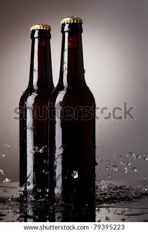 Beer bottles with water splash - stock photo