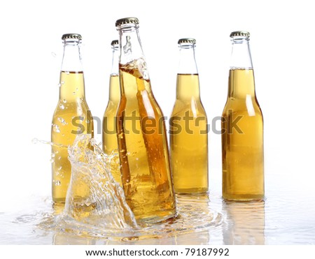 Beer bottles with water splash isolated on white - stock photo