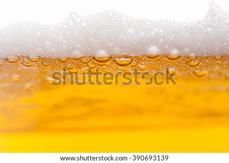 Beer bubbles in a mug, close-up image - stock photo