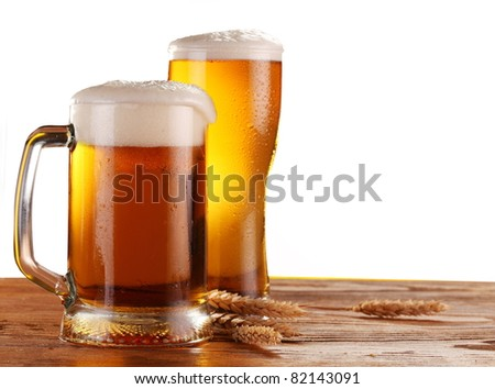 Beer by the glass on a white background. - stock photo