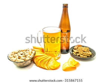 beer, chips, crackers and pistachios on white