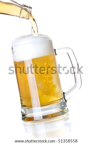 Beer collection - Beer is pouring into a glass from bottle