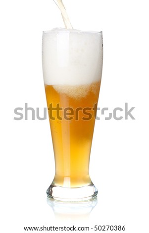 Beer collection - White beer is pouring into a glass from bottle