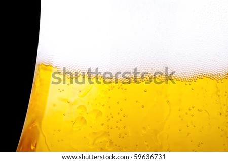 Beer, completely isolated on black background - stock photo