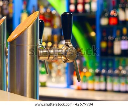 Beer crane in night club - stock photo