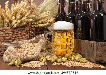 beer crate and beer glass with hops, wheat, grain, barley and malt